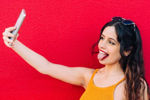 Portrait Of A Happy Young Woman Taking Selfie.