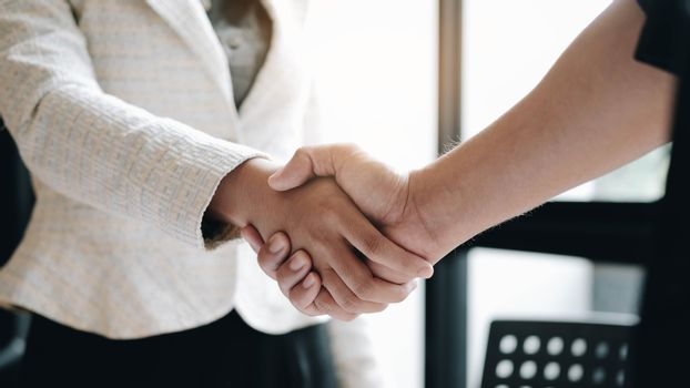 Business people shaking hands at meeting or negotiation, close-u