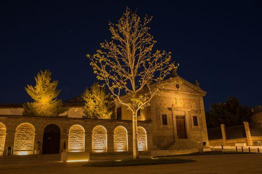 Night view of square in the front of Santa Teresa Convent in Avila, Spain