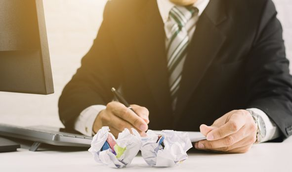 businessman emotions and fail concept crumpled paper on table with, unhappy no idea to thinking throwing papers in office