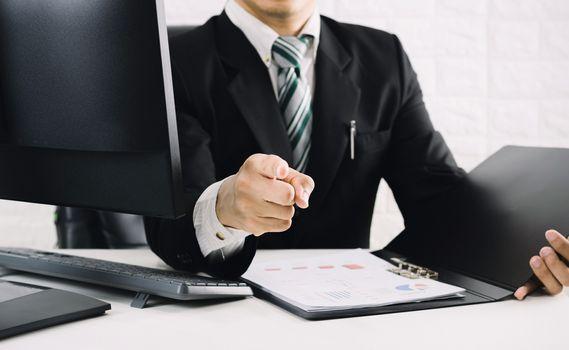 The boss business men pointing the finger on the desk