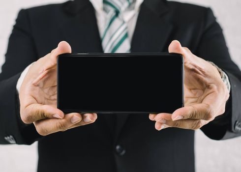 A business man with a show screen smartphone