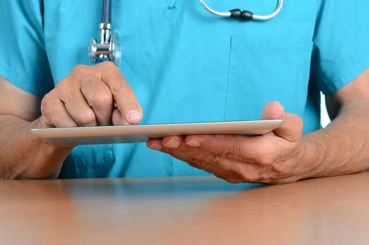 Closeup of a doctors hands holding a tablet computer.