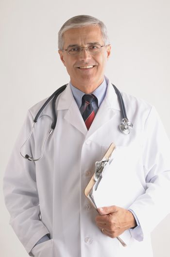 Smiling Middle Aged  Doctor in Labcoat with Stethoscope and Clip Board