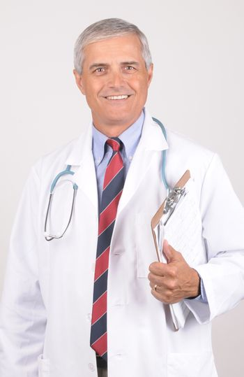 Portrait of a Middle Aged  Male Doctor in Lab Coat with Stethoscope and Clip Board