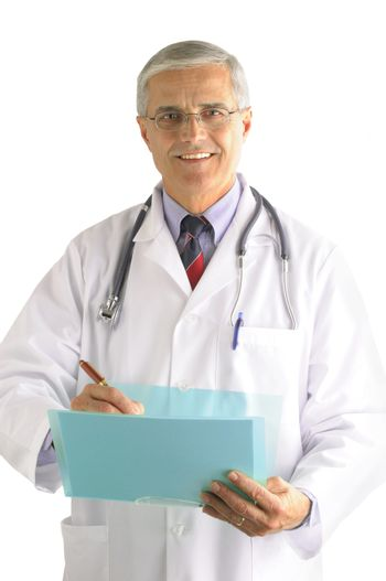 Middle aged doctor writing in a patients chart over light gray background vertical composition torso only