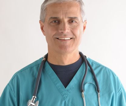 Close up of a Smiling Middle Aged  Doctor in Scrubs and Stethoscope square format