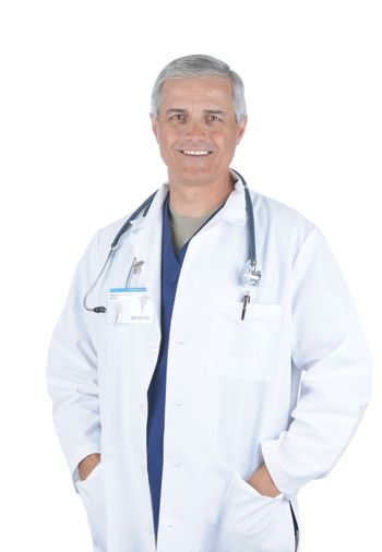 Middle Aged Male Doctor in Lab Coat and Scrubs with hands in pockets  and Stethoscope around his neck isolated on white
