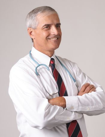 Profile Portrait of Smiling Middle Aged  Doctor with Stethoscope and arms crossed