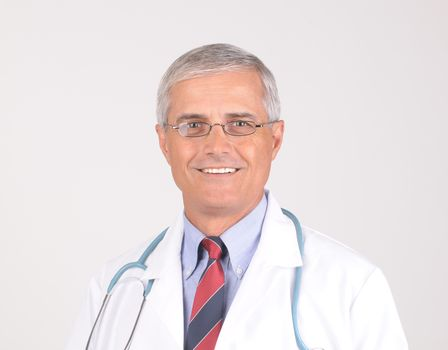 Portrait of a Middle Aged  Male Doctor in Lab Coat with Stethoscope - gray background