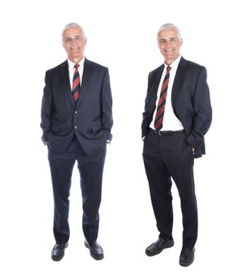 Two views of a mature businessman in full length in different poses, with his hands in his suit pockets, isolated on white.