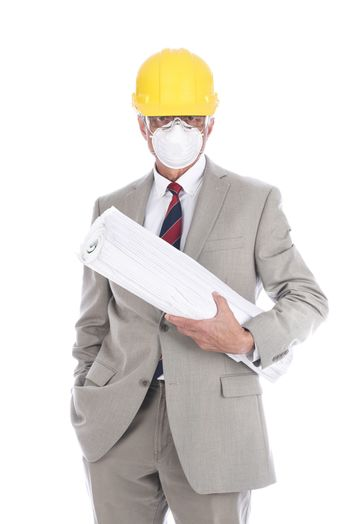 A businessman architect in a light tan suit wearing a hard had and protective face mask Holding a roll of blueprints. Isolated on White.