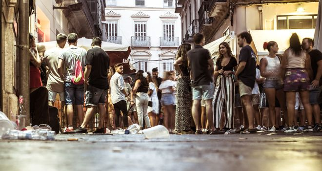 Malaga, Spain - August 12, 2018. People having fun in the historic center at the Feria de Malaga, an annual event that takes place in mid-August and is one of the largest fiestas in the Spain