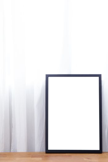 Empty black frame with place for text of on table. Scandinavian