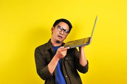 Frustrated Asian man with foolish face reading bad news. Tired sad male cannot work, bored, receiving dismissal notice, get fired, financial problems, depressed