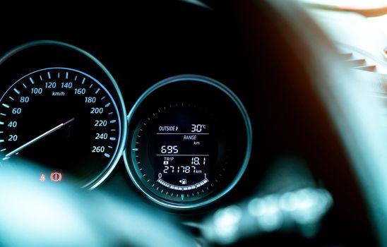 Closeup car fuel gauge dashboard panel. Gasoline indicator meter