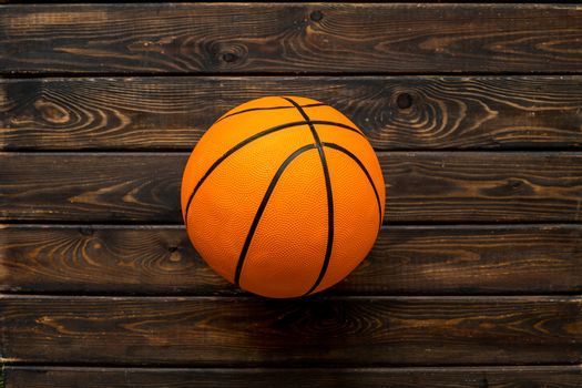 Basketball ball on wooden background top view copy space