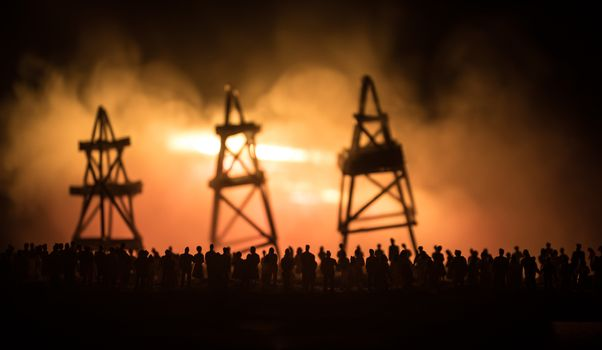 Oil industry crisis concept. Oil stock crisis because Covid global pandemic. Oil pump and oil refining factory at night with fog and backlight. Creative artwork decoration. Selective focus.