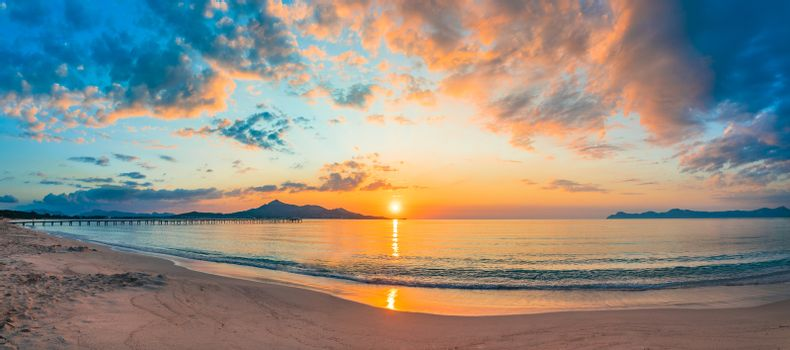 Idyllic view of romantic sunrise at morning on the beach