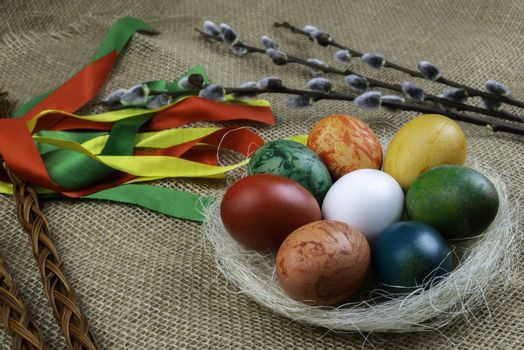 Czech rod with differently colored Easter eggs and with twigs of willow catkins