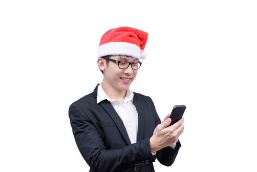 Business man has mobile playing with Christmas festival themes i