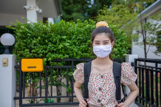 Asian women Smiling behind wearing protection mask on face for protection air pollution, particulates and for protection flu virus, influenza, coronavirus at city