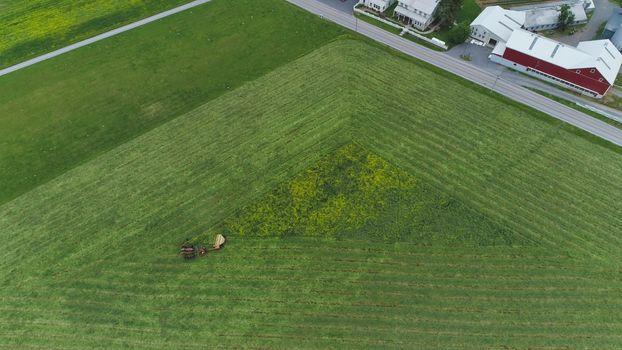 Aerial shot of an Amish farmer harvesting crop