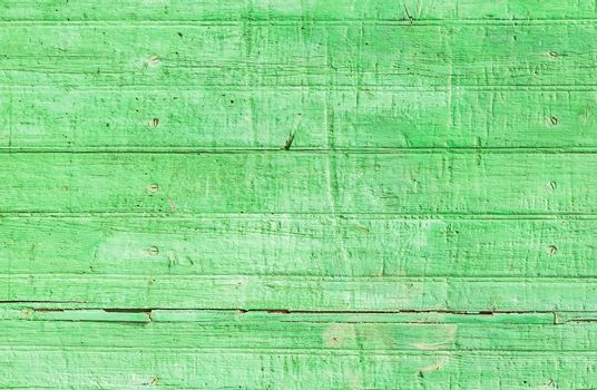 Rustic green colored wooden planks background texture with copy space
