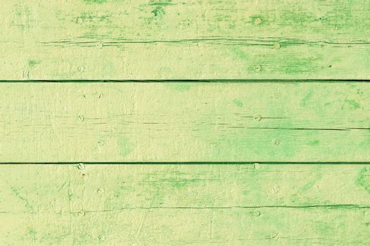 Rustic green colored wood backdrop texture with copy space