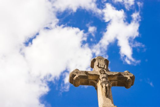 Cross against blue cloudy sky, religion christianity concepts background