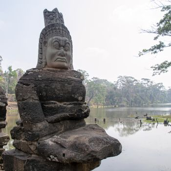 Angkor Wat Temple Cambodia - March 2018: Stone Asura at bridge leading into the 12th century city of Angkor Thom.
