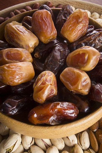 Set of nuts and dried fruits on a wooden table