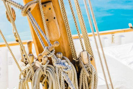Detail view of old sailing yacht rigging on wooden mast
