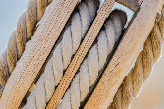 Extreme close-up of pulley with ropes of a classical sailing yacht