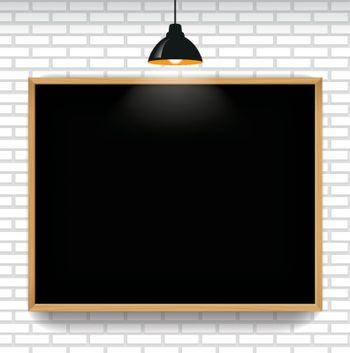 Blank blackboard in white brick wall background with hanging light