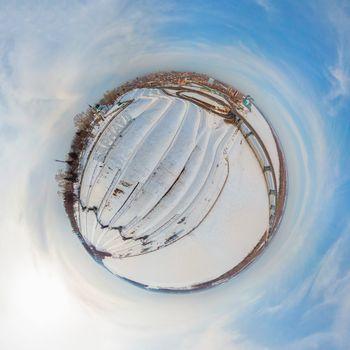 360 spherical panorama of aerial shot of bridge and car driving on the bridge, winter sunny day in Barnaul, Siberia, Russia