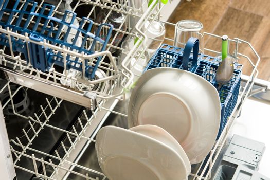 Open dishwasher with dirty crockery