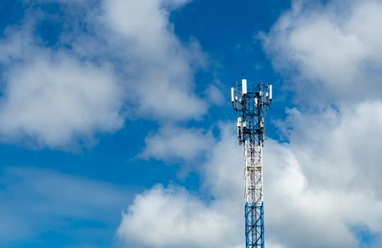 Telecommunication tower with blue sky and white clouds. Antenna on blue sky. Radio and satellite pole. Communication technology. Telecommunication industry. Mobile or telecom 4g network. Technology