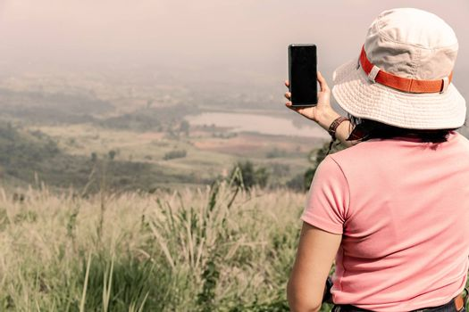 Tourists taking photo of natural scenery