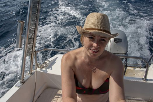 Croatia, Hvar - June 2018: Caucasian woman, sat in a small boat on vacation