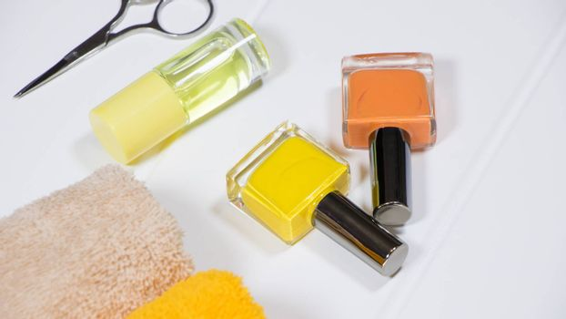 Manicure. Set of nail polishes on a white background. The bottles of nail Polish. Nail care spa set. Composition for nail salon. Woman desktop. Manicure and pedicure equipment for nail bar set.