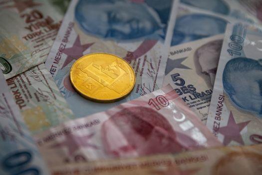 Bunch of Various Turkish Lira Banknotes and Litecoin