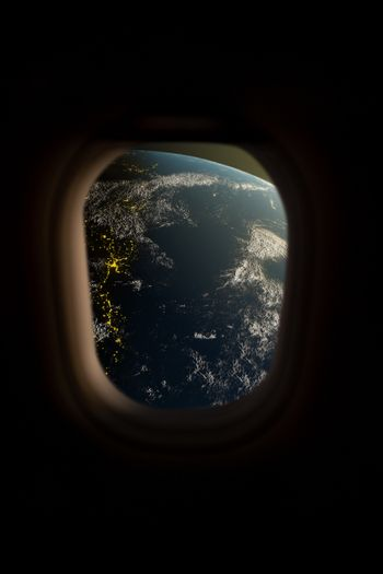 Earth view from spaceship window.