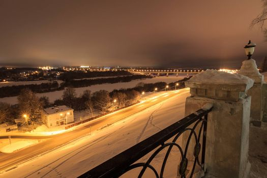 night city at winter season with cloudu sky and lights