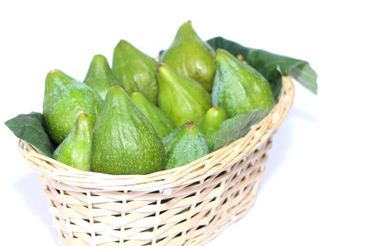 Figs on wicker basket isolated on white