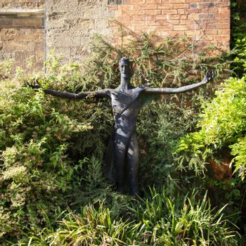 UK, Launde Abbey, Leicestershire - July 2018: Modern Statue of Christ in the abbey garden