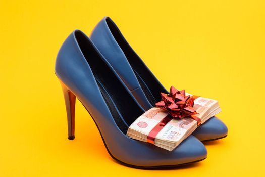 Birthday girl gift blue high-heeled shoes and a pack of five-thousandth bills