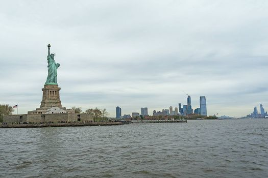 USA, New York - May 2019: Statue of Liberty, Liberty Island, with Manhtattan in the background