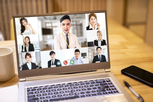 closeup  laptop computer screen with business group video conference