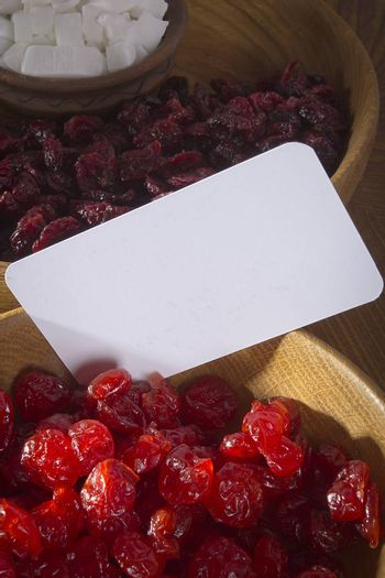 Candied dried cherries in a wooden plate